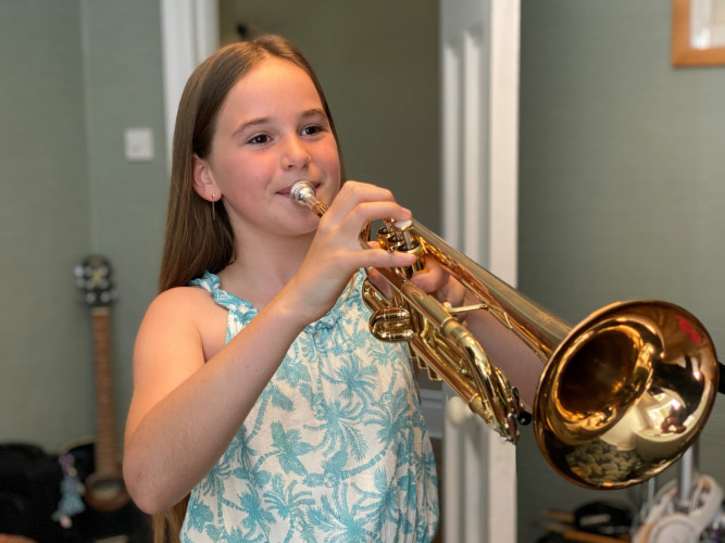 Izzy Playing Her Trumpet 2