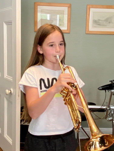 Izzy Playing Her Trumpet